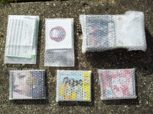 bubble wrapped CDs in box